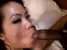 Sexy narrow eyed Mia Parks gets poked hard in a missionary position by a hard black dick