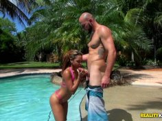 Sexed girl Guiliana Alexis getting her body oiled by pool side